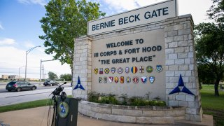 FORT HOOD, TX - JUNE 03: Media outlets gather outside the Bernie Beck gate at Fort Hood on June 3, 2016 in Fort Hood, Texas. The media were hoping for more information on drowning casualties and missing soldiers during training at the army base that occurred June 2.