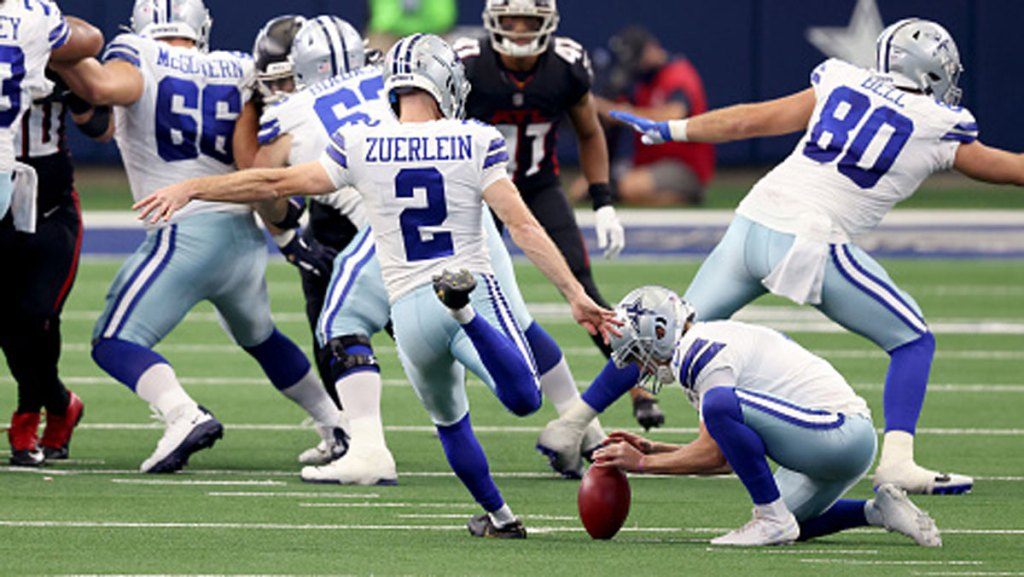 Greg Zuerlein #2 of the Dallas Cowboys kicks the game-winning field goal against the Atlanta Falcons in the final seconds of the fourth quarter at AT&T Stadium on Sept. 20, 2020 in Arlington, Texas.