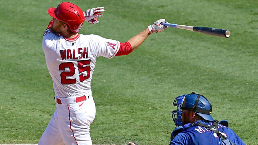 Jared Walsh #25 of the Los Angeles Angels hits a grand slam home run in the fourth inning against the Texas Rangers at Angel Stadium of Anaheim on Sept. 21, 2020 in Anaheim, California.