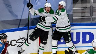 Joel Kiviranta #25 of the Dallas Stars is congratulated by his teammates after scoring a goal against the Colorado Avalanche during the third period in Game Seven of the Western Conference Second Round during the 2020 NHL Stanley Cup Playoffs at Rogers Place on Sept. 4, 2020 in Edmonton, Alberta, Canada.