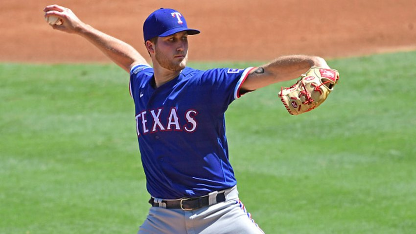 Kyle Cody #73 of the Texas Rangers pitches in the first inning against the Los Angeles Angels at Angel Stadium of Anaheim on Sept. 20, 2020 in Anaheim, California.