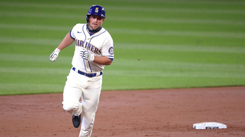 Kyle Seager #15 of the Seattle Mariners rounds the bases on his two-run home run against the Texas Rangers in the first inning at T-Mobile Park on Sept. 6, 2020 in Seattle, Washington.
