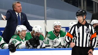 Head coach Rick Bowness of the Dallas Stars speaks from behind the bench during the first period of Game Two of the NHL Stanley Cup Final between the Dallas Stars and the Tampa Bay Lightning at Rogers Place on Sept. 21, 2020 in Edmonton, Alberta, Canada.