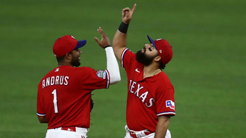 Elvis Andrus #1 and Rougned Odor #12 of the Texas Rangers celebrate a 5-2 win against the Oakland Athletics at Globe Life Field on Sept. 12, 2020 in Arlington, Texas.