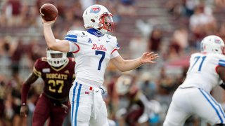 Shane Buechele #7 of the Southern Methodist Mustangs looks to pass under pressure by London Harris #27 of the Texas State Bobcats in the second half at Bobcat Stadium on Sept. 5, 2020 in San Marcos, Texas.