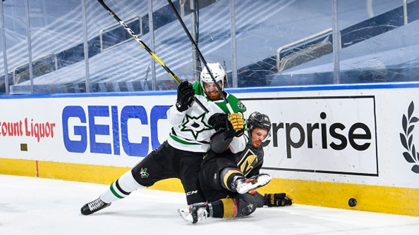 Stephen Johns #28 of the Dallas Stars battles for the puck against Nick Cousins #21 of the Vegas Golden Knights during the first period of a Round Robin game during the 2020 NHL Stanley Cup Playoff at Rogers Place on Aug. 3, 2020 in Edmonton, Alberta.