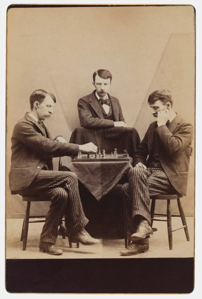 Unknown photographer playing chess against myself