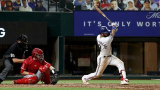 Isiah Kiner-Falefa #9 of the Texas Rangers hits a single against the Los Angeles Angels in the bottom of the fifth inning at Globe Life Field on Sept. 9, 2020 in Arlington, Texas.