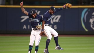 J.P. Crawford #3 (L) and Kyle Lewis #1 of the Seattle Mariners celebrate their 8-4 win against the Texas Rangers at T-Mobile Park on Sept. 7, 2020 in Seattle, Washington.