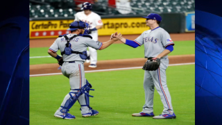 Kyle Gibson #44 of the Texas Rangers hugs Jeff Mathis #2 after pitching a complete game win over the Houston Astros at Minute Maid Park on September 16, 2020 in Houston, Texas.