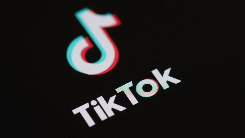 This May 27, 2020, photo taken in Paris shows the logo of the social network application TikTok on the screen of a phone.