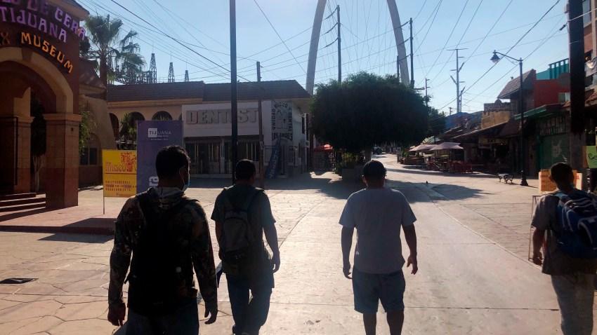Expelled migrants walking in Tijuana, Mexico, Oct. 8, 2020.