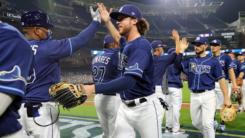 Brett Phillips #14 of the Tampa Bay Rays celebrates with teammates after the Rays defeated the New York Yankees in Game 2 of the ALDS at Petco Park on Tuesday, Oct. 6, 2020 in San Diego, California.