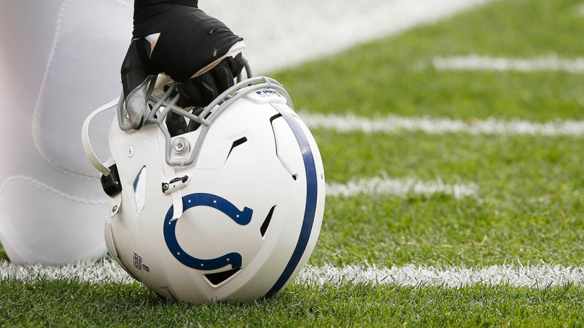 An Indianapolis Colts helmet sits on the turf prior to an NFL game between the Indianapolis Colts and the Cleveland Browns on Oct. 11, 2020, at FirstEnergy Stadium in Cleveland, Ohio.