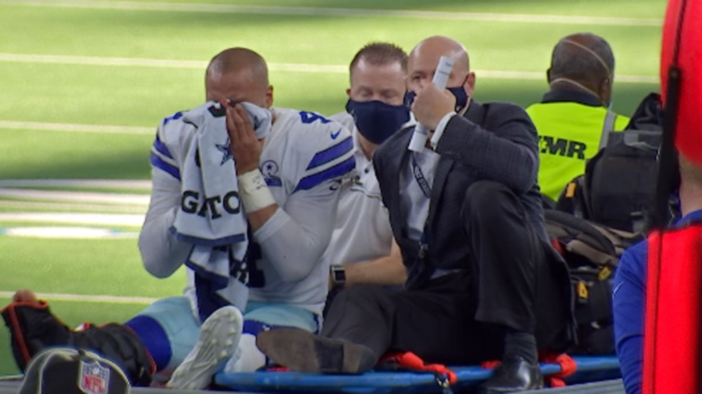 Dallas Cowboys quarterback Dak Prescott is carted off the field after injuring his right ankle against the New York Giants at AT&T Stadium in Arlington, Texas on Sunday, Oct. 11, 2020.