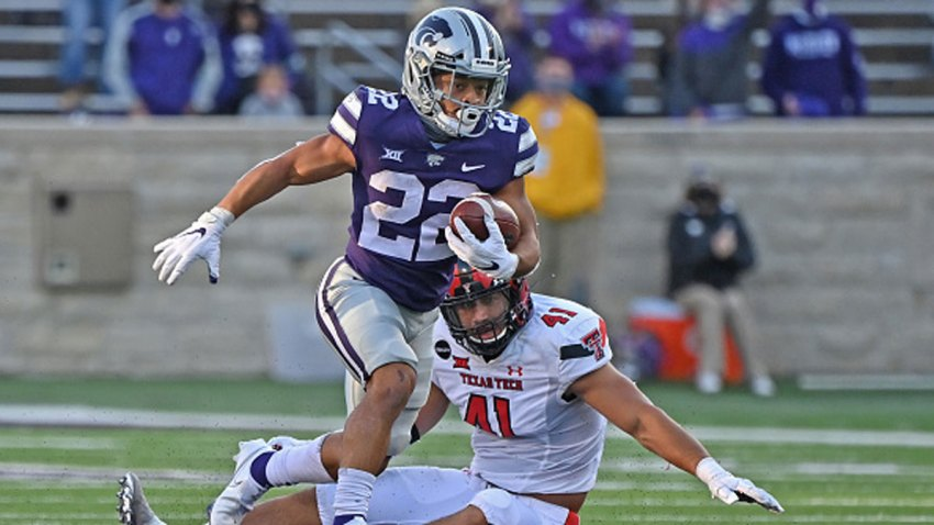 Running back Deuce Vaughn #22 of the Kansas State Wildcats rushes past linebacker Jacob Morgenstern #41 of the Texas Tech Red Raiders, after catching a pass for a touchdown during the second half at Bill Snyder Family Football Stadium on Oct. 3, 2020 in Manhattan, Kansas.