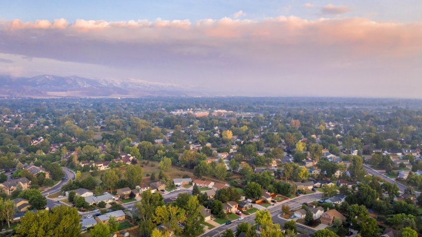 In this September 2020 file photo, smoke from the Cameron Peak Fire casts a smoky sky over Fort Collins, Colorado. The fire has become the largest in the state's history.