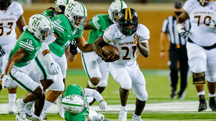 Southern Miss Golden Eagles running back Frank Gore Jr. (21) breaks through the line of scrimmage during the game between the North Texas Mean Green and the Southern Miss Golden Eagles on Oct. 3, 2020 at Apogee Stadium in Denton, Texas.
