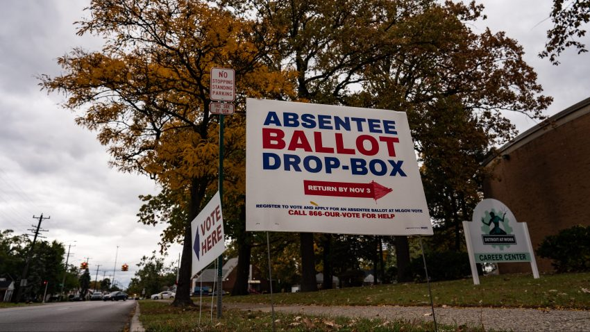 A sign directing voters to the absentee ballot drop-box at one of the Satellite Voting Center inside Northwest Activity Center during early U.S. Presidential Election voting in Detroit, Michigan on Thursday, October 15, 2020.