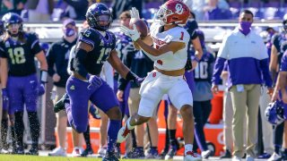 Oklahoma Sooners running back Seth McGowan (1) catches a pass for a first down over TCU Horned Frogs linebacker Dee Winters (13) during the game between the TCU Horned Frogs and the Oklahoma Sooners on October 24, 2020 at Amon G. Carter Stadium in Fort Worth, Texas.