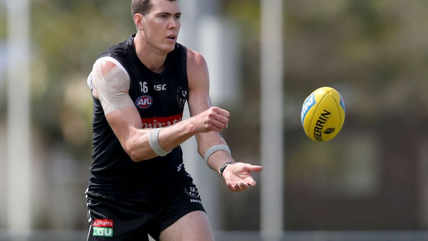 Mason Cox of the Magpies makes a handpass during a Collingwood Magpies AFL training session at Maroochydore Multi Sports Complex on September 02, 2020 in Sunshine Coast, Australia.