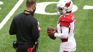 Kyler Murray #1 of the Arizona Cardinals talks to head coach Kliff Kingsbury during the game against the New York Jets at MetLife Stadium on October 11, 2020 in East Rutherford, New Jersey. Arizona Cardinals defeated the New York Jets 30-10.