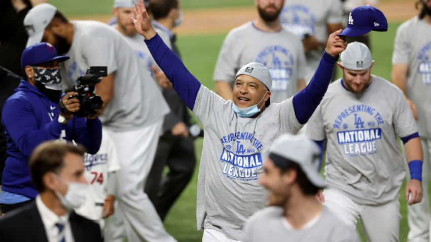 Manager Dave Roberts of the Los Angeles Dodgers celebrates with his team following their 4-3 victory against the Atlanta Braves in Game Seven of the National League Championship Series at Globe Life Field on October 18, 2020 in Arlington, Texas.