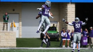 FILE: Kansas State Wildcats defensive back AJ Parker (12) leaps in celebration after a sack by defensive end Kyle Alan Ball (44) in the third quarter of a Big 12 football game between the Oklahoma State Cowboys and Kansas State Wildcats on Oct. 13, 2018 at Bill Snyder Family Stadium in Manhattan, Kansas.