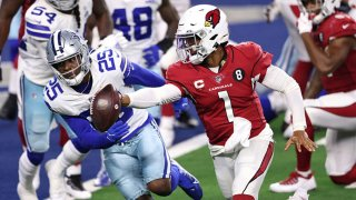 Kyler Murray #1 of the Arizona Cardinals runs for a touchdown against Xavier Woods #25 of the Dallas Cowboys during the third quarter at AT&T Stadium on Oct. 19, 2020, in Arlington, Texas.