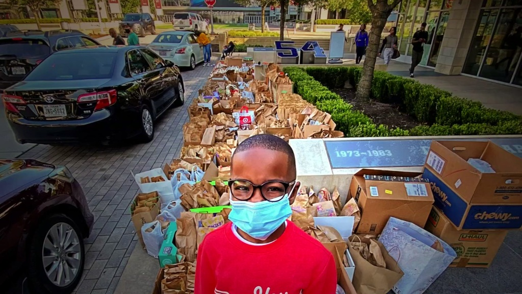 """Orion Jean's Fort Worth house is filled with brown paper bags. """"This is 'Race to 100,000 Meals',"""" Jean said surrounded by bags. """"Five bags help, 20 bags help, One bag helps!"""""""