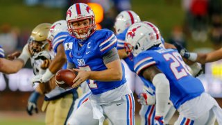 Southern Methodist Mustangs quarterback Shane Buechele (7) looks hand off the football to running back Ulysses Bentley IV (26) during the game between the Southern Methodist Mustangs and the Navy Midshipmen on Oct. 31, 2020 at Gerald Ford Stadium in Dallas, Texas.