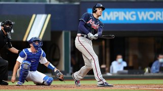 Freddie Freeman #5 of the Atlanta Braves hits a two-run home run in the fourth inning during Game 2 of the NLCS between the Atlanta Braves and the Los Angeles Dodgers at Globe Life Field on Tuesday, Oct. 13, 2020 in Arlington, Texas.