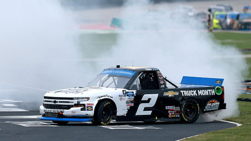 Sheldon Creed, driver of the #2 Chevy Truck Month Chevrolet, celebrates with a burnout after winning the NASCAR Gander RV & Outdoors Truck Series SpeedyCash.com 400 at Texas Motor Speedway on Oct. 25, 2020 in Fort Worth, Texas.