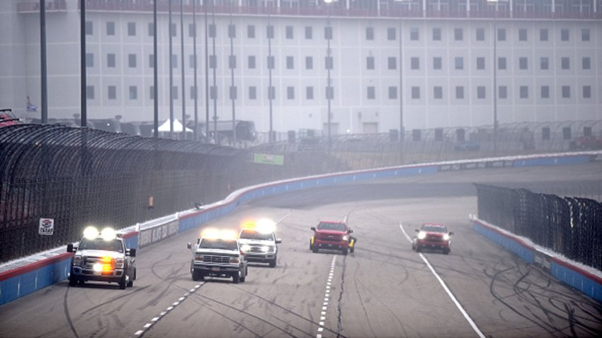 Track officials use a jet dryer to dry the track during the NASCAR Cup Series Autotrader EchoPark Automotive 500 at Texas Motor Speedway on Oct. 25, 2020 in Fort Worth, Texas.