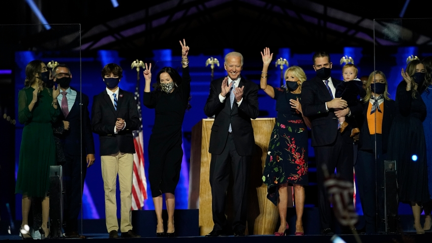 President-elect Joe Biden, center with his wife Jill Biden , right, and members of their family on stage waving to supporters, Saturday, Nov. 7, 2020, in Wilmington, Del.