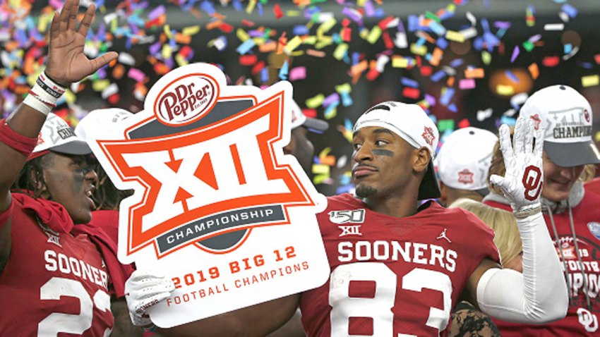 Todd Hudson #23 of the Oklahoma Sooners and teammate Nick Basquine #83 celebrate the teams 30-23 win over the Baylor Bears following the Big 12 Football Championship at AT&T Stadium on Dec. 7, 2019 in Arlington, Texas.