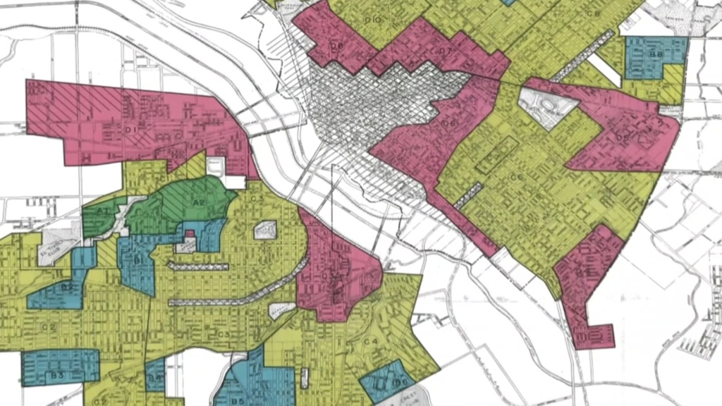The practice of 'redlining,' outlawed years ago, is still seen as a factor in the lack of progress for some Dallas neighborhoods, according to community leaders.