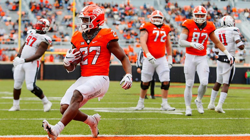 Running back Dezmon Jackson #27 of the Oklahoma State Cowboys steps into the endzone for a touchdown after following outside the center against the Texas Tech Red Raiders in the second quarter at Boone Pickens Stadium on Nov. 28, 2020 in Stillwater, Oklahoma. Jackson had three touchdowns in the first half.