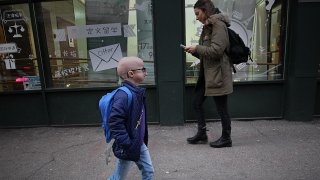 Meghan Waldron, a freshman at Emerson College, walks on the street in Boston on Feb. 12, 2020. She has progeria, one of the world's rarest diseases. It causes premature aging and typically kills kids by the age of 14. She's almost 19, and she credits lonafarnib, an experimental drug she's been taking since 2007 as part of a clinical trial at Boston Children's Hospital.