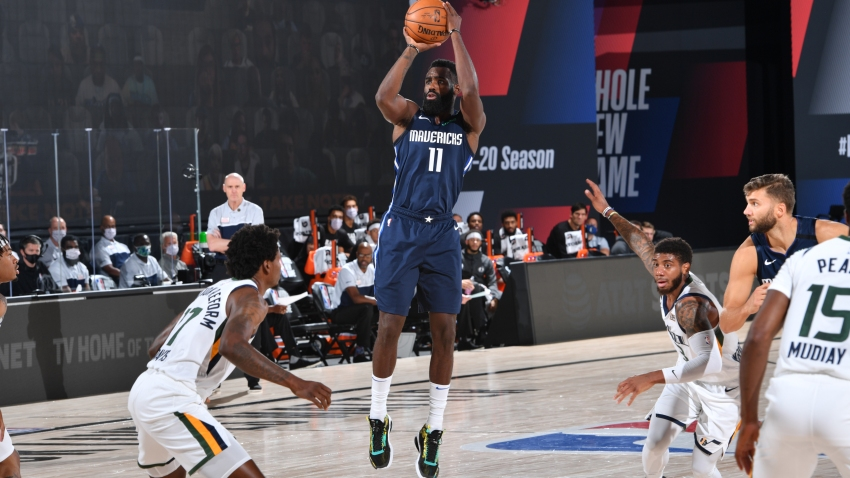Tim Hardaway Jr. #11 of the Dallas Mavericks shoots the ball against the Utah Jazz on August 10, 2020 at the AdventHealth Arena at in Orlando, Florida.