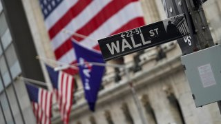 A Wall Street sign is seen nearby the New York Stock Exchange in New York