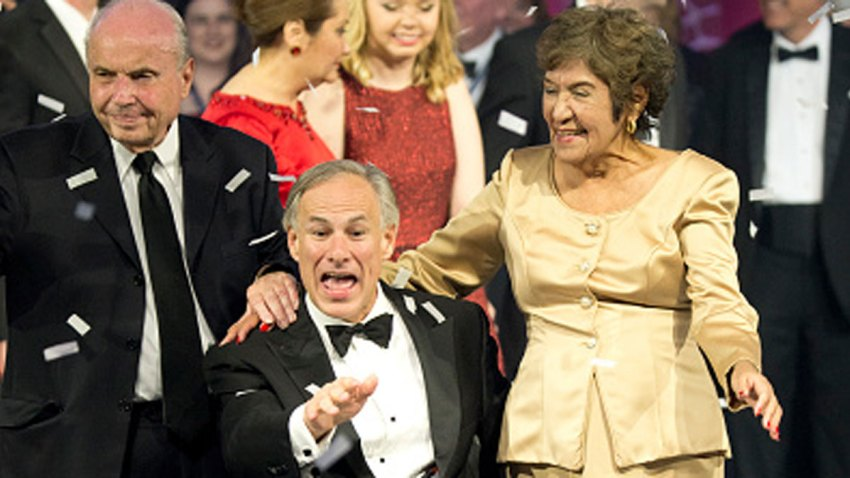 FILE -- Texas Gov. Greg Abbott celebrates his inauguration as the 48th Governor of Texas onstage at the 2015 Texas Inaugural Ball with his mother-in-law, Mary Lucy Phalen, and father-in-law from San Antonio.