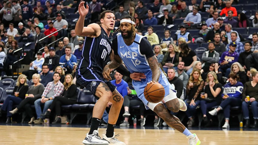 James Johnson #16 of the Minnesota Timberwolves drives to the basket against Aaron Gordon #00 of the Orlando Magic in the first quarter of the game at Target Center on March 6, 2020 in Minneapolis, Minnesota.