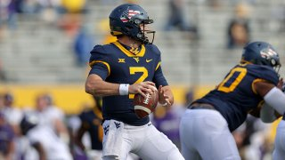 West Virginia Mountaineers quarterback Jarret Doege (2) looks to pass during the third quarter of the college football game between the TCU Horned Frogs and the West Virginia Mountaineers on Nov. 14, 2020, at Mountaineer Field at Milan Puskar Stadium in Morgantown, West Virginia.