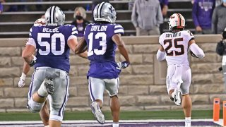 Safety Jason Taylor II #25 of the Oklahoma State Cowboys returns a fumble 85-yards for a touchdown against the Kansas State Wildcats during the fourth quarter at Bill Snyder Family Football Stadium on Nov. 7, 2020 in Manhattan, Kansas.