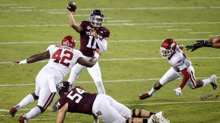 Kellen Mond #11 of the Texas A&M Aggies throws a pass under pressure by Jonathan Marshall #42 of the Arkansas Razorbacks in the first quarter at Kyle Field on Oct. 31, 2020 in College Station, Texas.