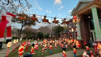 Grapevine Family Displays Hundreds of Santa Decorations in Front Yard for a Good Cause