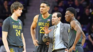 Head coach Scott Drew of the Baylor Bears talks with players Devonte Bandoo #2, Tristan Clark #25 and Matthew Mayer #24, during the first half against the Kansas State Wildcats at Bramlage Coliseum on Feb. 3, 2020 in Manhattan, Kansas.