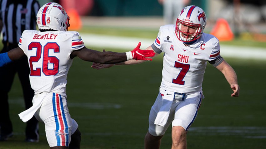 Ulysses Bentley IV #26 and Shane Buechele #7 of the Southern Methodist Mustangs react after a touchdown against the Temple Owls in the fourth quarter quarter at Lincoln Financial Field on Nov. 5, 2020 in Philadelphia, Pennsylvania. The Southern Methodist Mustangs defeated the Temple Owls 47-23.