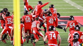 The Texas Tech Red Raiders celebrate on the field after the game winning field goal by kicker Jonathan Garibay #46 after the college football game against the Baylor Bears at Jones AT&T Stadium on Nov. 14, 2020 in Lubbock, Texas.